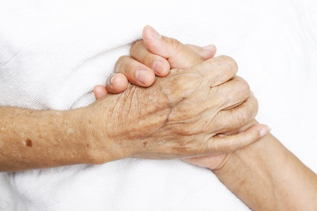 Woman Comforting Hand with Old woman Stock Photo