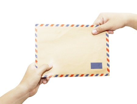 Passing mail, man s hand passes the envelope to another hand isolated on white background