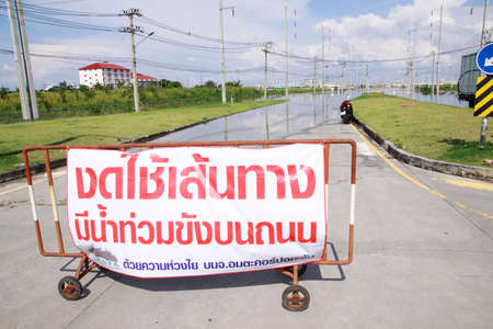 inconvenient: CHONBURI THAILAND - 18 OCT 2013   Road Closed Due To Flooding road sign  Water flooding attack to Amata Nakorn Industrial Estate in Chonburi Thailand