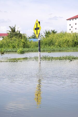 inconvenient: CHONBURI THAILAND - Oct 18,2013    Traffic signs submerged  Water flooding attack to Amata Nakorn Industrial Estate in Chonburi Thailand Editorial