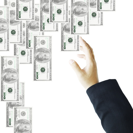 pick money: La mano del hombre de negocios alcanza hasta la selecci�n de dinero Foto de archivo