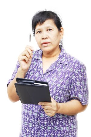 senior woman holding pen and notebook Stock Photo