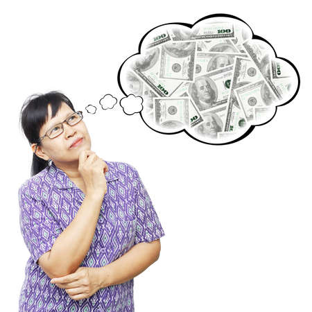 Thinking Asia woman looking up on thought bubble of money stack