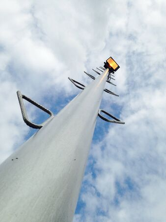 Floodlight stand with the sky and cloudy