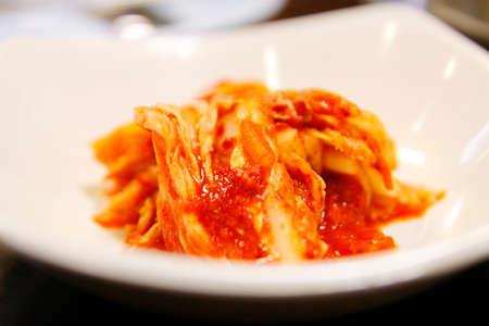 Korean food, close-up kimuchi on white dish