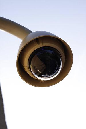 Hi-tech dome type camera on a wall
