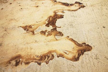 Oil and Sand, Oil Spill on Beach Stock Photo