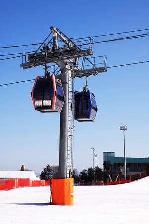 Two ski lift cable cars at ski resort Stock Photo