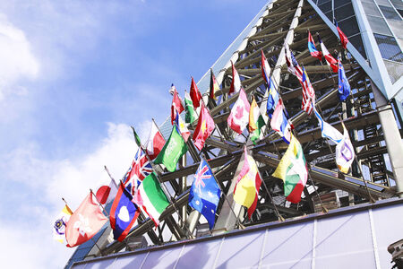International Flags blowing in the wind Stock Photo