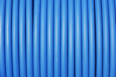 photo of close-up blue cable stored on reel Stock Photo