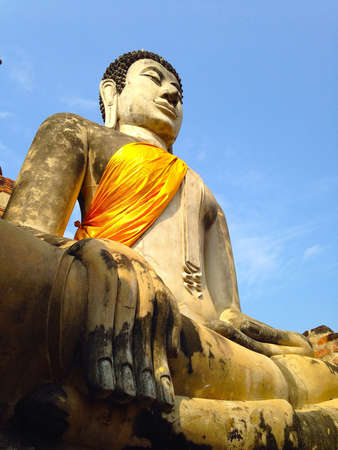 Stone statue of a Buddha at old temple Ayutthaya Thailand