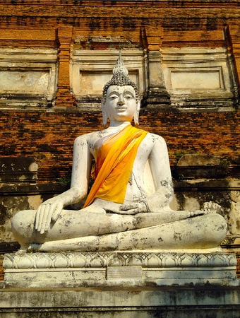 Stone statue of a buddha in ruined old temple at Ayutthaya Thailand Stock Photo