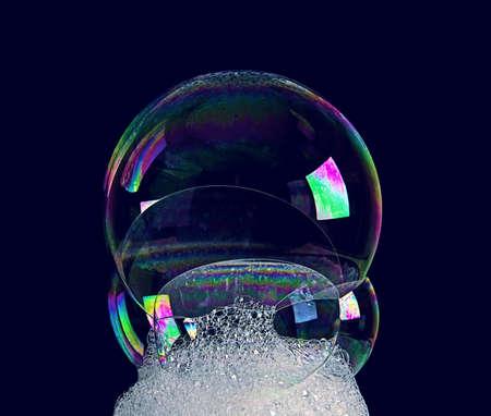 Soap bubble on dark background
