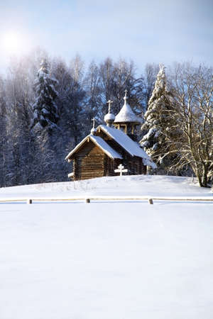 Wooden church covered with snow Stock Photo