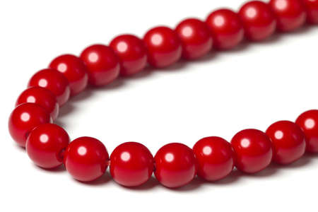 Red beads on white background