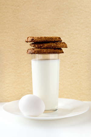 Breakfast with milk, egg and cookies Stock Photo
