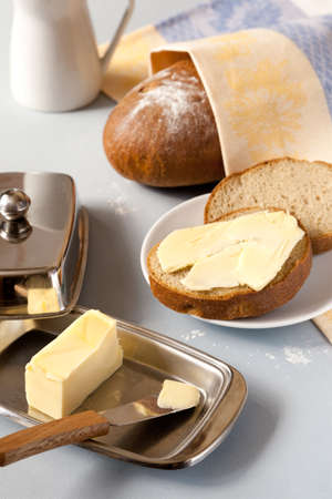 Bread with  butter slices for breakfast and  loaf of bread on the background Stock Photo