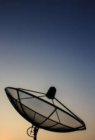 recieve: The silhouette display of black satellite in twilight duration Stock Photo