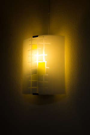 A lantern shine attaching with the wall of my bedroom photo