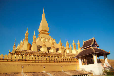 Pha That Luang with blue sky at Laos photo