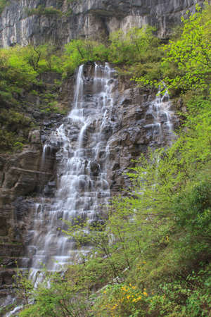 The smooth flow of waterfall next to the heaven doors at Tien mansan photo