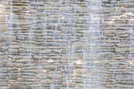 brick background: Brick background with waterfall Stock Photo