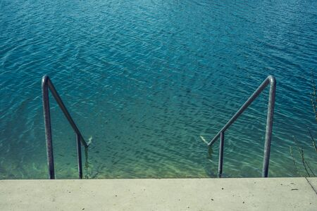 Ladder in the lake with beautiful water