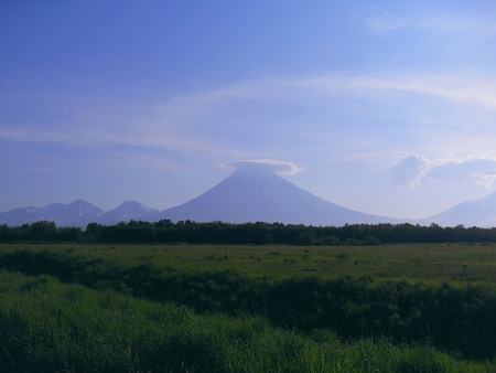 field and the volcano Фото со стока