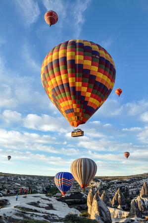 goreme: Hot air balloon in sunrise over Goreme Cappadocia Turkey Stock Photo