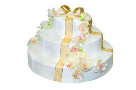 Wedding cake with white icing decorated with orchids