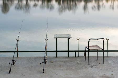 Fishing equipment on the lake photo