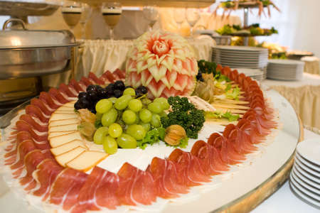 Food arrangement with ham and fruits Stock Photo