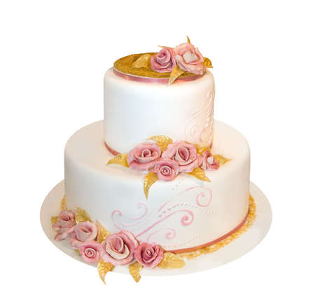 Wedding cake decorated with marzipan roses (isolated on white)