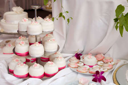 Table decorated with wedding cakes photo
