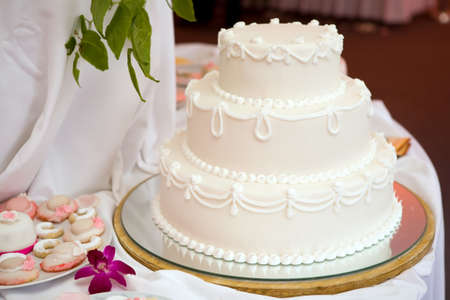 Three tiered wedding cake with white icing Stock Photo