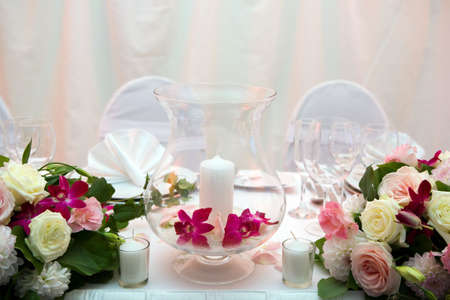 Romantic dinner with candles and flowers