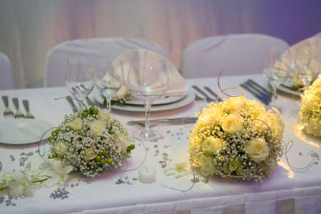 Beautiful yellow roses decorating wedding dinner table Stock Photo - 3911164
