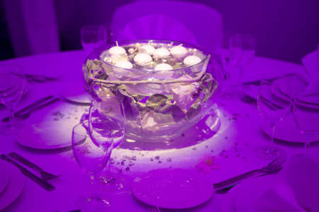 candle light table setting: Wedding dinner in purple Stock Photo