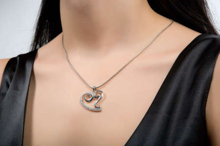 Beautiful necklace with heart pendant on a models neck