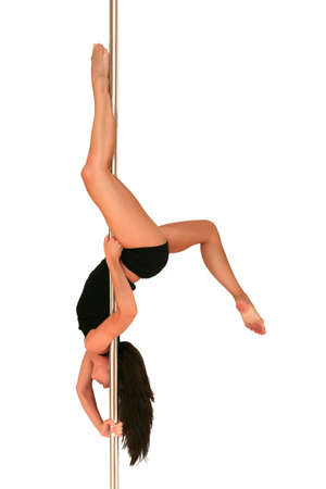 Young woman exercising pole dance fitness Stock Photo
