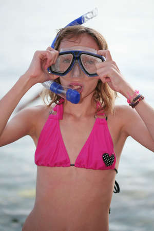 Teenage girl with snorkeling mask photo