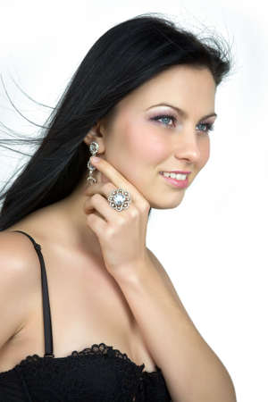 Diamonds are forever (girl with diamond earrings and a ring) photo