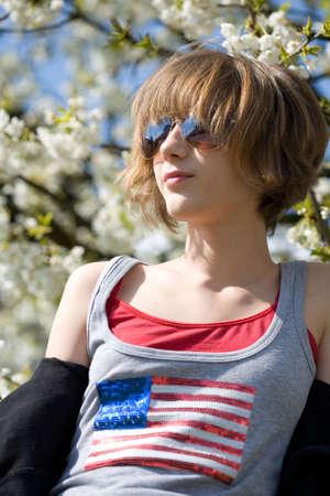 Teenage girl sunbathing in the park photo