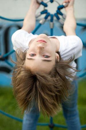 Teenage girl on the playground photo