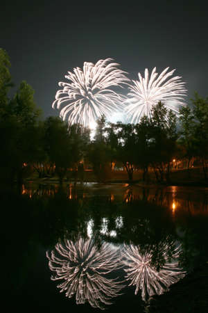 Fireworks with reflection in the lake  photo