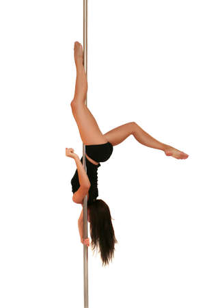 Young woman exercising pole dance fitness  Stock Photo - 7924763