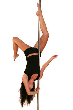 stripper: Young woman exercising pole dance fitness