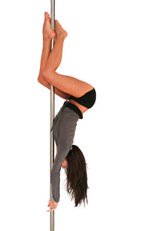 Young woman exercising pole dance fitness  photo