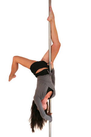 poledance: Young woman exercising pole dance fitness