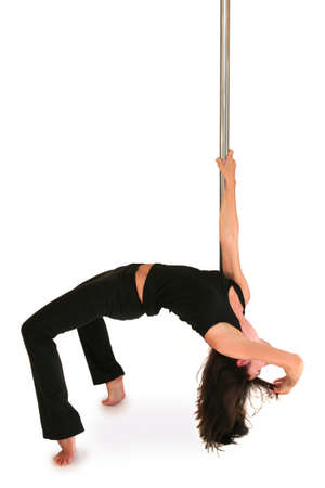 women s health: Young woman exercising pole dance fitness Stock Photo